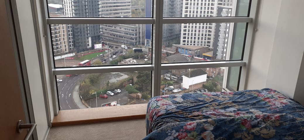 Private Double Bed room + bath in a high rise