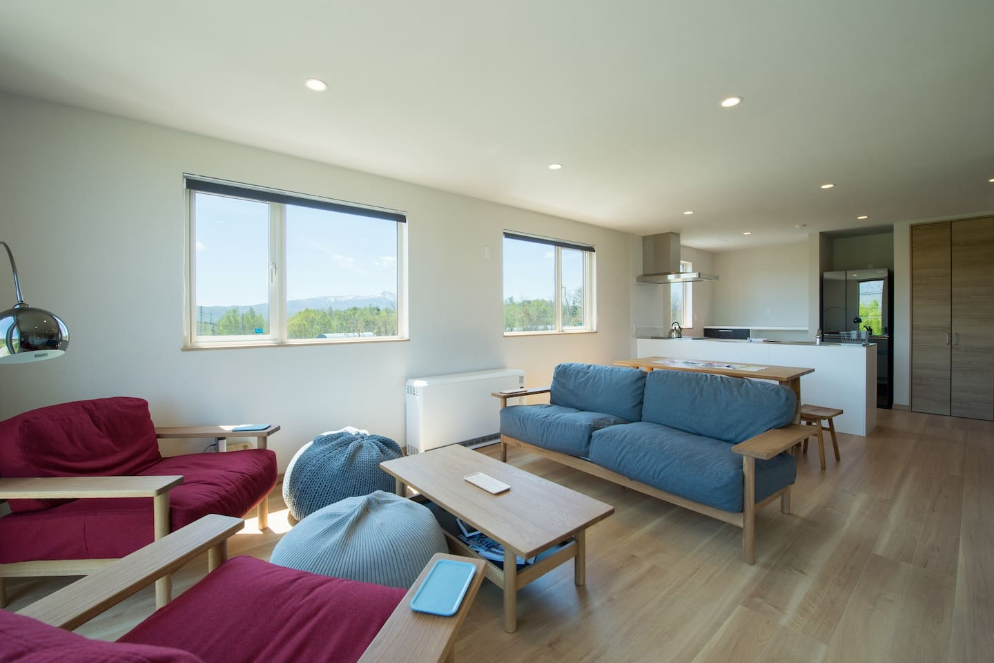 Open-plan living, dining and kitchen with views of Mt Yotei