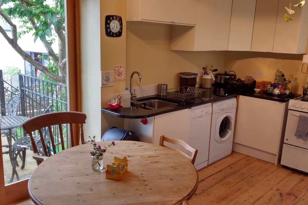 Kitchen, washing machine, dishwasher, table and 4 chairs.