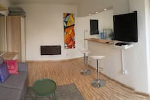 Studio with nice and cool living area with sofabed, open bar & kitchen, toilet & shower and huge outdoor terrace with lounge/cafe and BBQ area.