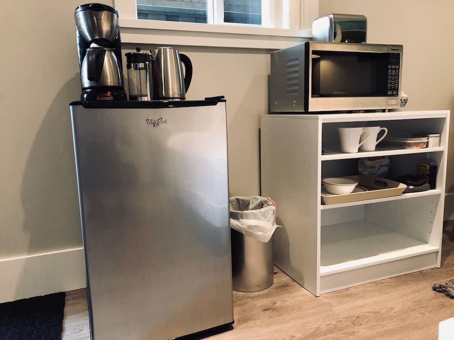 Coffee pot, kettle, mini fridge with freezer, microwave, toaster, dishes & cutlery, Organic coffee, tea, sugar, dish soap, tea towels, paper towels, dishes & cutlery provided.