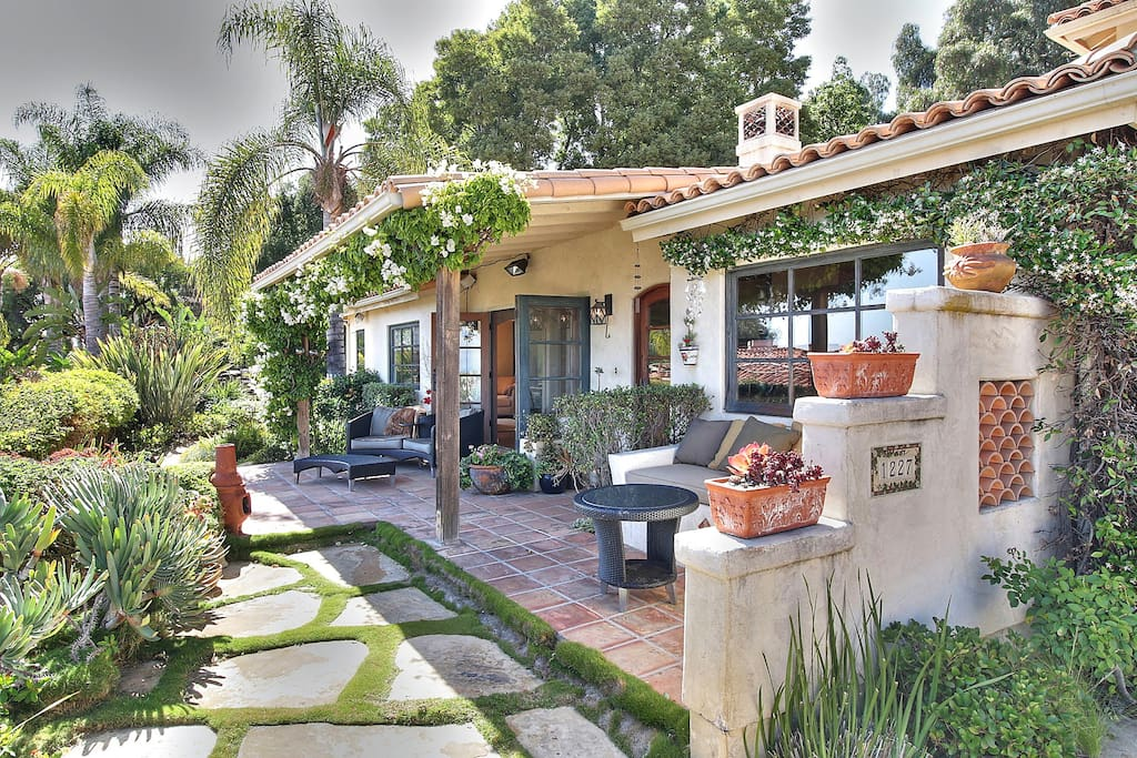 Lush landscaping and fabulous design on the patio.