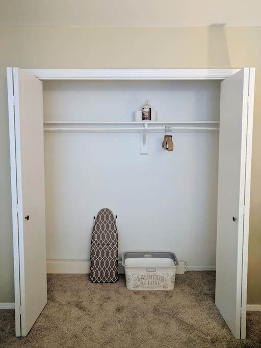 Full size closet with ironing board and laundry basket. Extra pillows and blanket are available