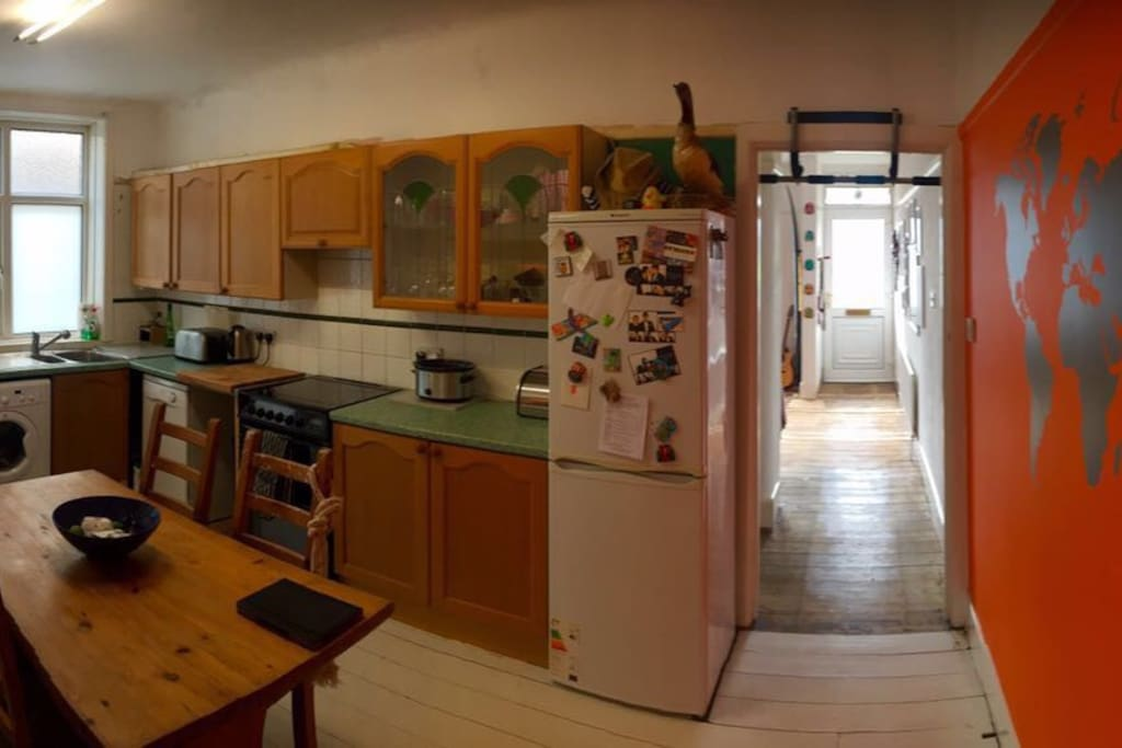 Spacious kitchen with dinner table, fridge, freezer, washing machine, oven and all kitchen amenities at your disposal.