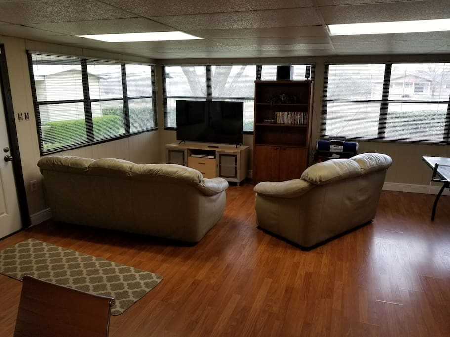Sunroom with Ping Pong table, movies, and games.  Perfect hangout for the family or the kids