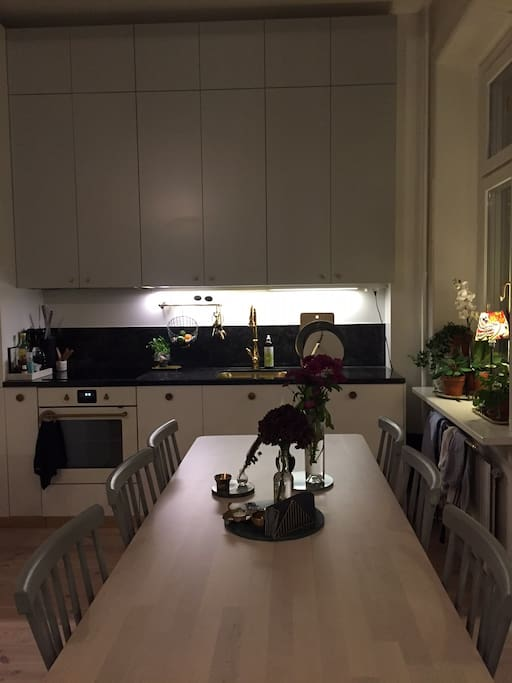 Large dinner table with 6 chairs but room for 8 persons