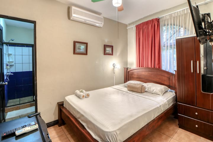 Hotel room w/ great location, A/C, hot water, & shared pool - close to the beach