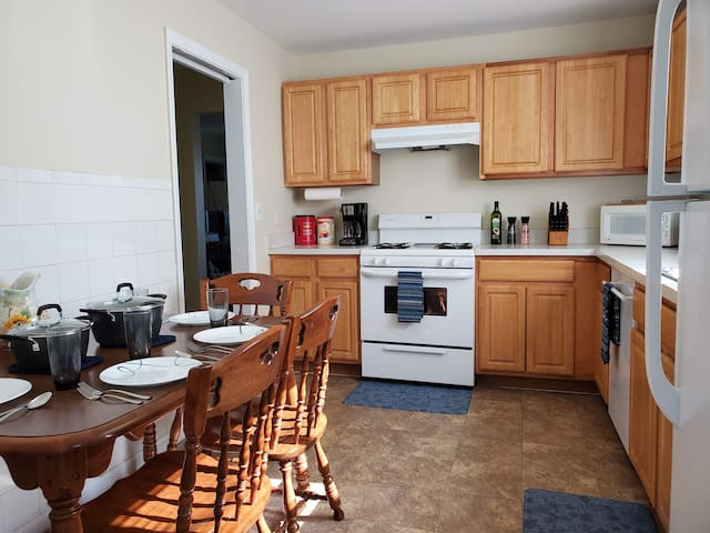 Our kitchen is fully stocked for your convenience. We have a full-size refrigerator, oven & range, microwave, coffee maker, toaster. We have enough table settings for 8 people. We have also provided coffee & creamer, cooking oil, and salt & pepper.