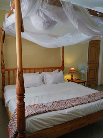King size bed fitted with mosquito net