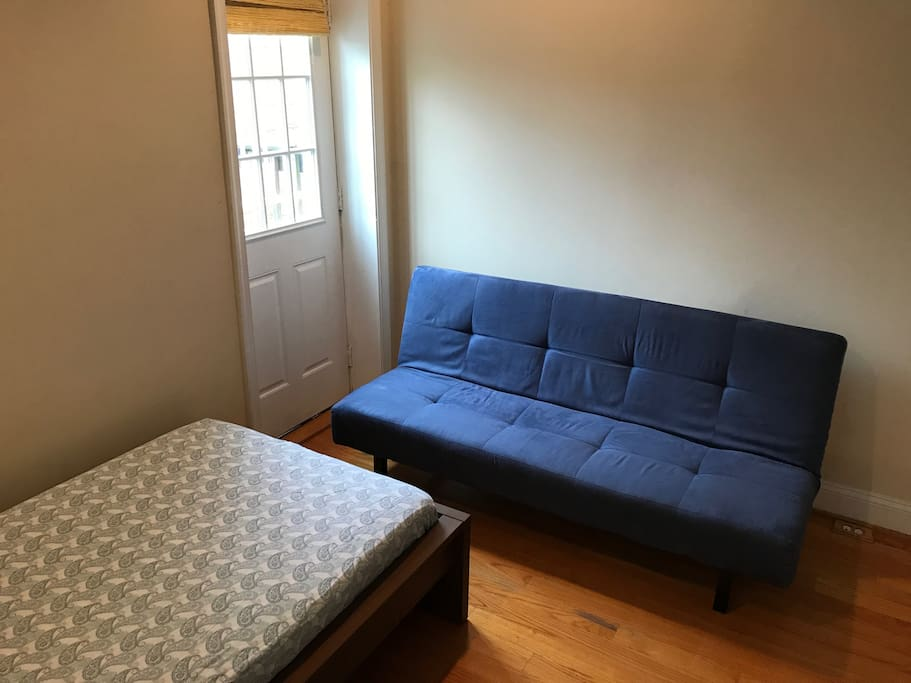 Twin sized bed and IKEA Sofa bed for additional persons.