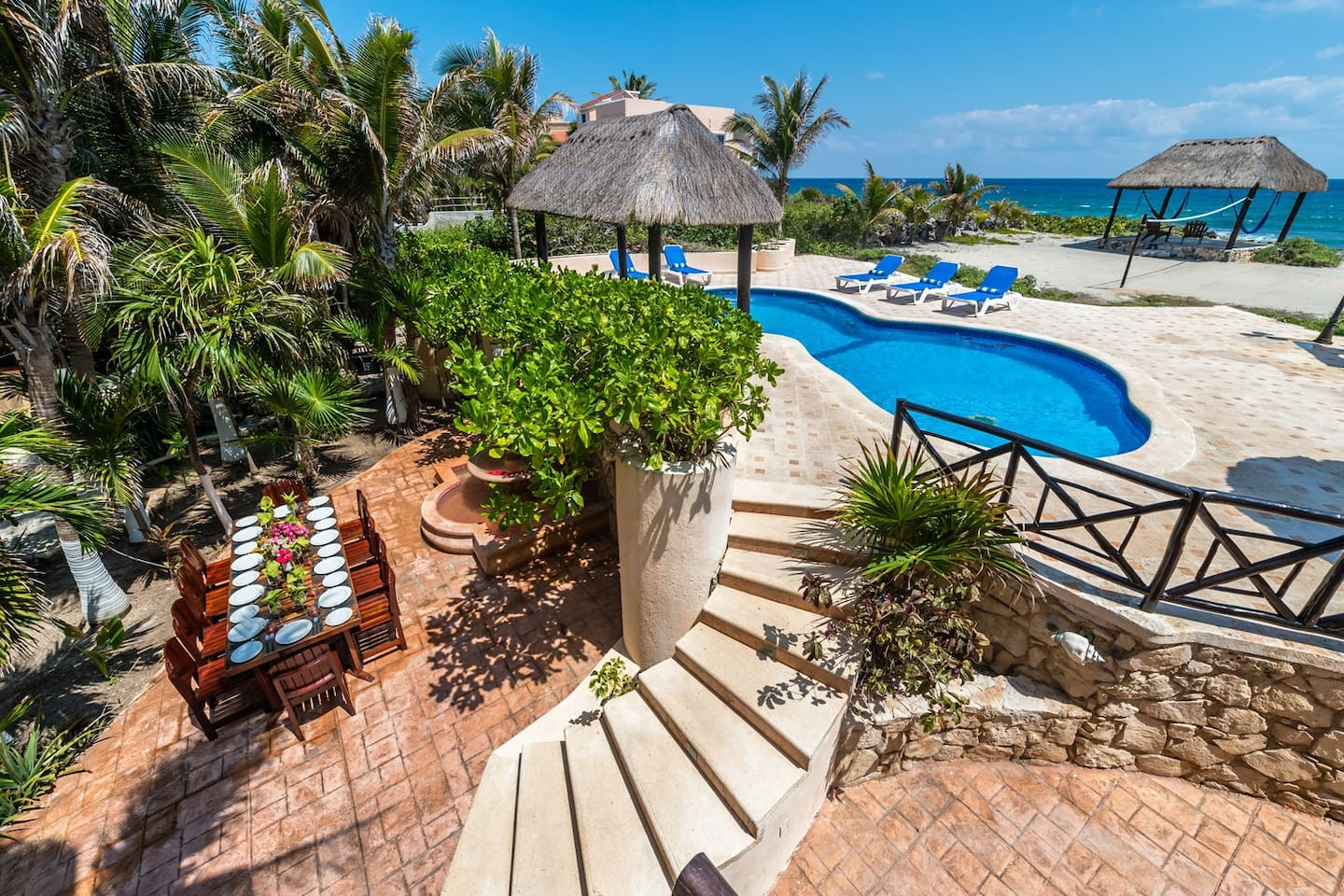 Casa Iguana exterior.  A perfect oceanside playground located in Akumal.  Two sandy beaches are a 5-minute walk from the property.