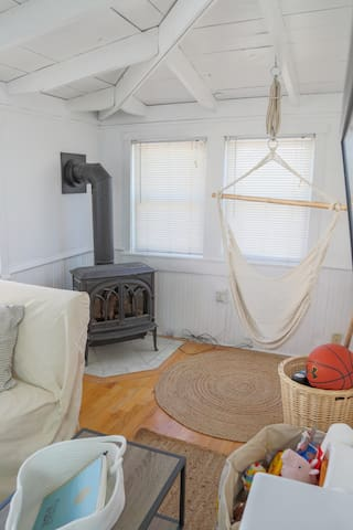 Take a load off after a tough day at the beach in the hammock chair. If you're feeling chilly, turn on the propane fireplace to warm up.