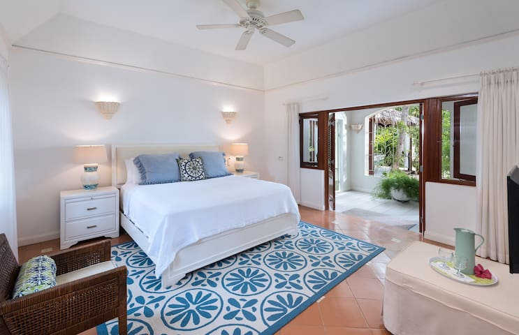 "Comfortable and Spacious ""Hibiscus"" Bedroom equipped with air conditioning."