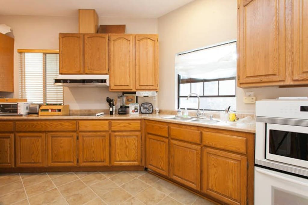 Full kitchen with microwave, oven, sink and stove