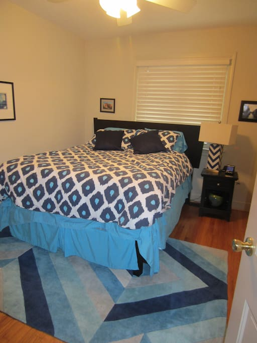 Room includes a queen sized bed (with box spring),  nightstand, closet, small chest of drawers and ceiling fan.