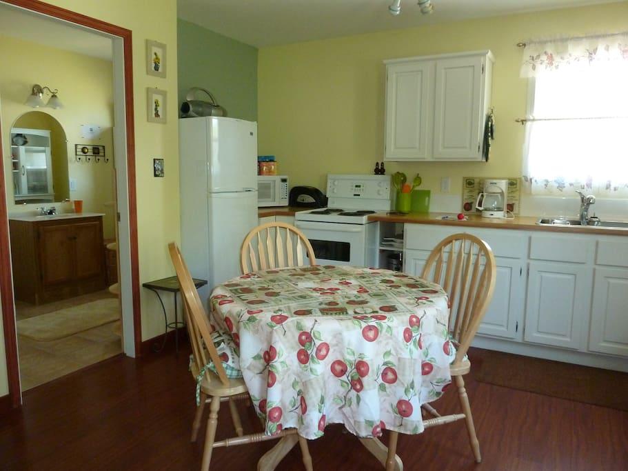 Kitchen, stove, microwave, fridge, table