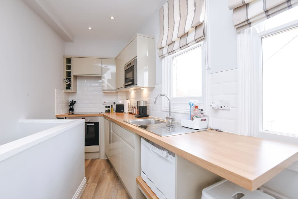 Kitchen with fridge (& freezer section), wine fridge, conventional oven, hob, microwave oven, dish washer, washer dryer, toaster / kettle and crockery & cutlery.