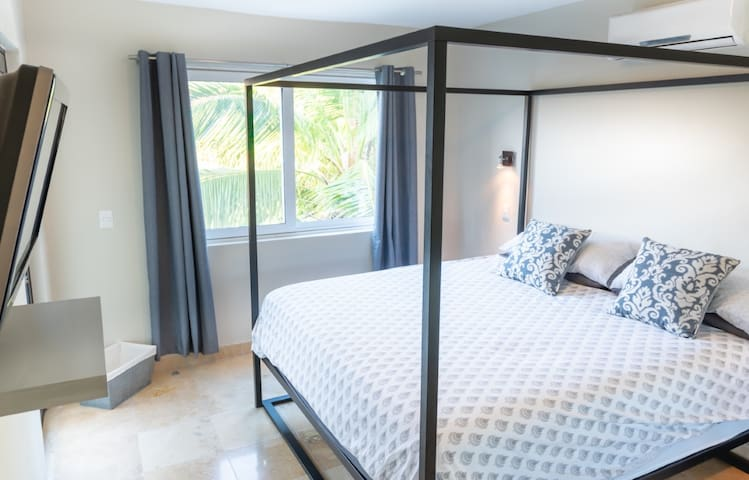 The Master Bedroom comes with its own En-suite, ample closet, flat screen, and has direct access to the terrace.