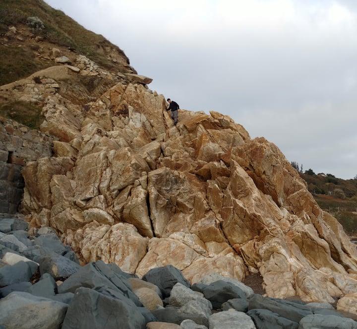 Climb over beach boulders