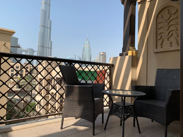 Lovely Balcony with Table and Chairs suitable for the breakfast or a romantic dinner with the view of Burj Khalifa