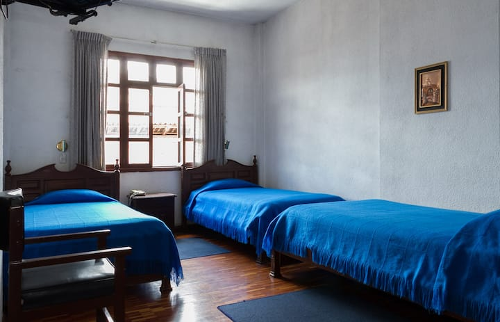 Triple room in Downtown Quito.
