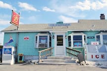 The Cottage is a local convenience store which has a great selection of wine, beer, and other vacation needs.   Plum Island Provisions is across the street  which delivers + has incredible food.  We HIGHLY recommend the breakfast sandwiches + pizza.