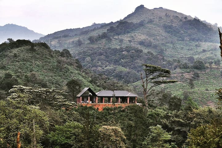 The villa situated on top of a hill, sorrounded by vast forest land & river flowing through the 560 acre property