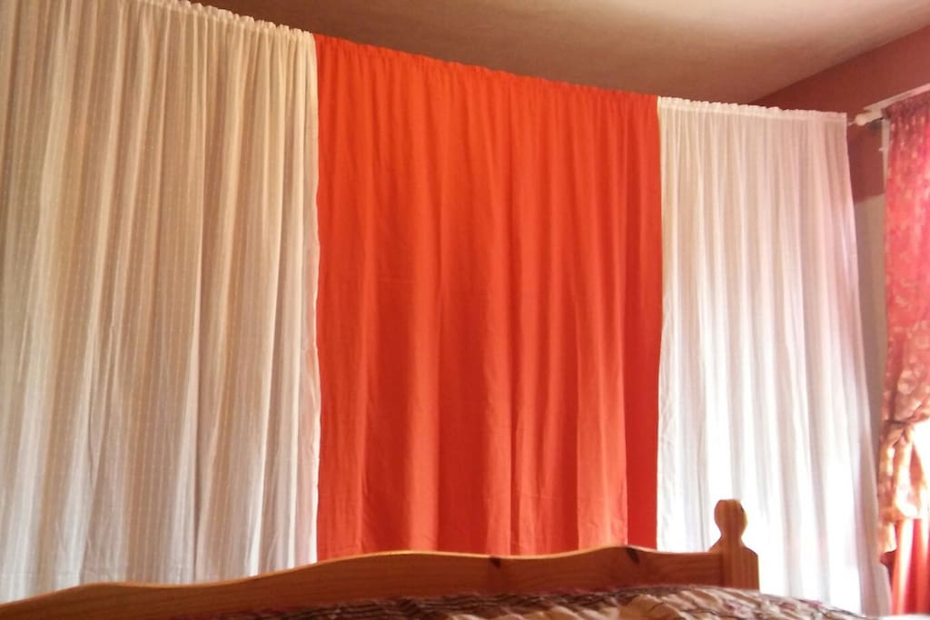 Privacy curtains hide the futon completely.
