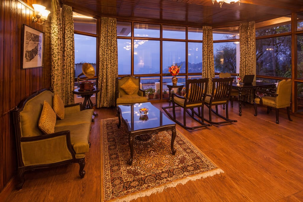 The colonial style lobby offers a panoramic view of the mountains