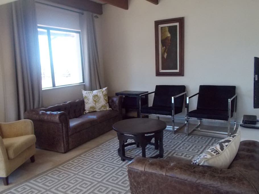 Lounge with flat screen tv/DSTV