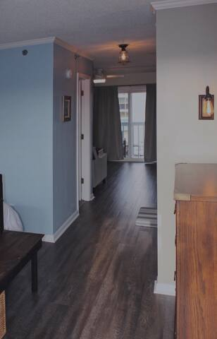 The condo is shotgun-style, with the bedroom area just inside the front door, leading to the den.
