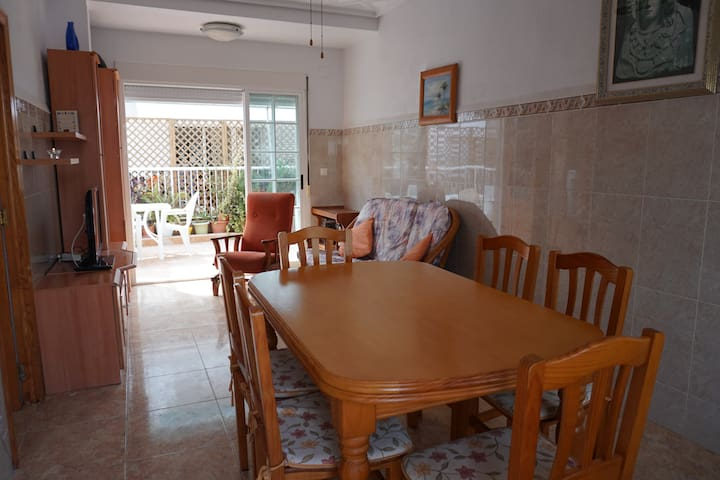 House with large terrace, 1 min from beach by walk