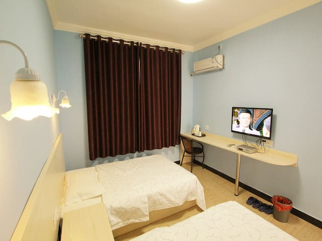 Twin beds room 99yuan per night for ordinary days