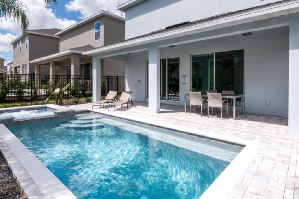 Covered lanai, outdoor dining area, private swimming pool and a spillover tub