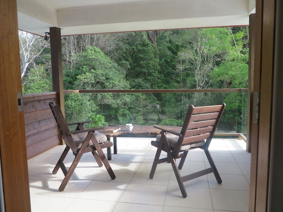 Soak up the rainforest bird sounds from your private deck.