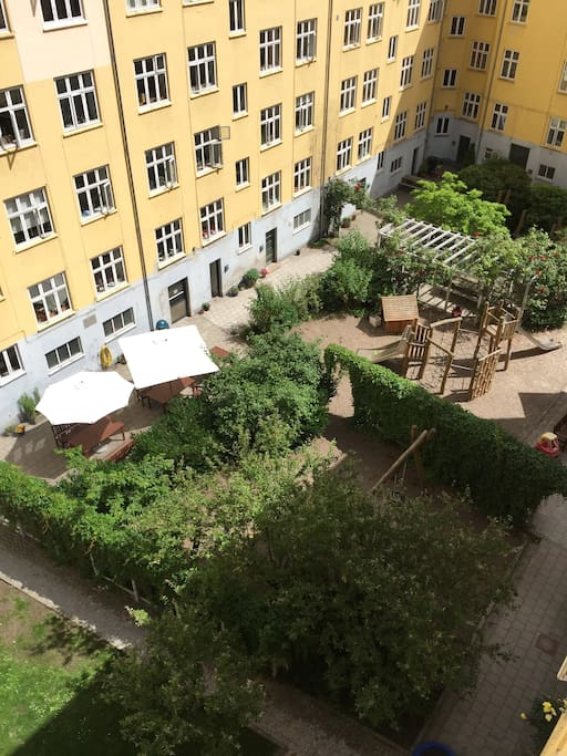 View down to the garden outside which you will have access to. Great place for lunch or for children to play. There is also access to a rooftop balcony with chairs and tables and umbrellas in the warmer months.
