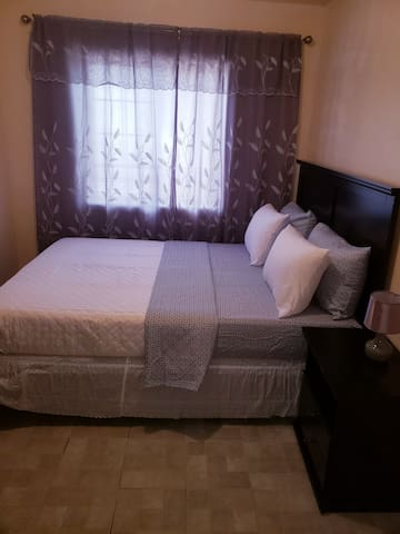 Bronx honey room with comfortable bed.