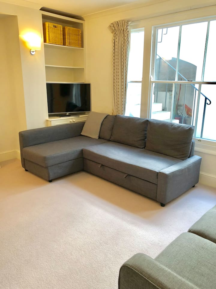 Spacious living room with double sofa bed