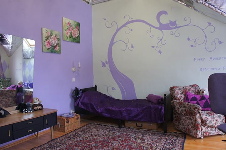 Purple room in the country house of an artist
