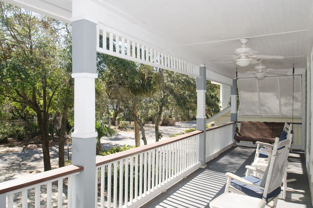 The covered porch with rocking chairs awaits you.