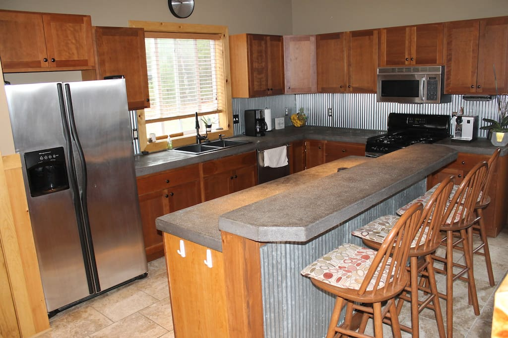 Spacious kitchen with everything you could possibly need to entertain.  All cooking utensils included along with a grill for cooking outdoors