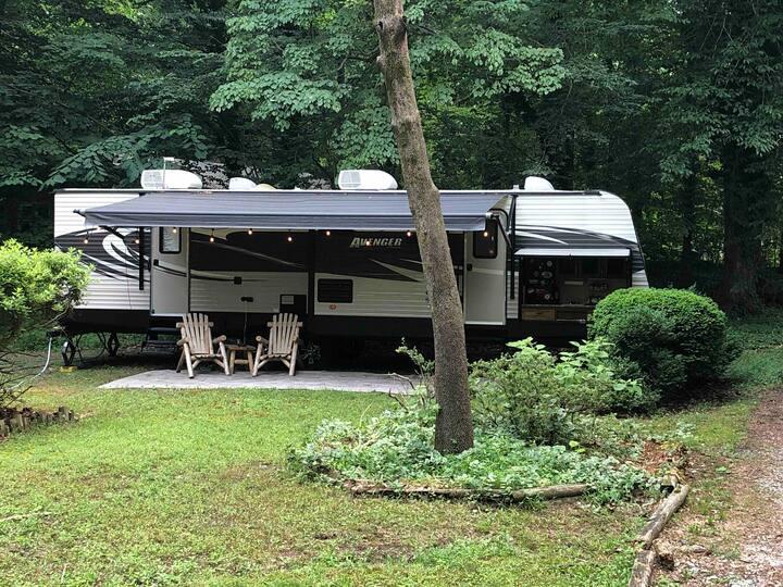 A quiet camper in a private setting.