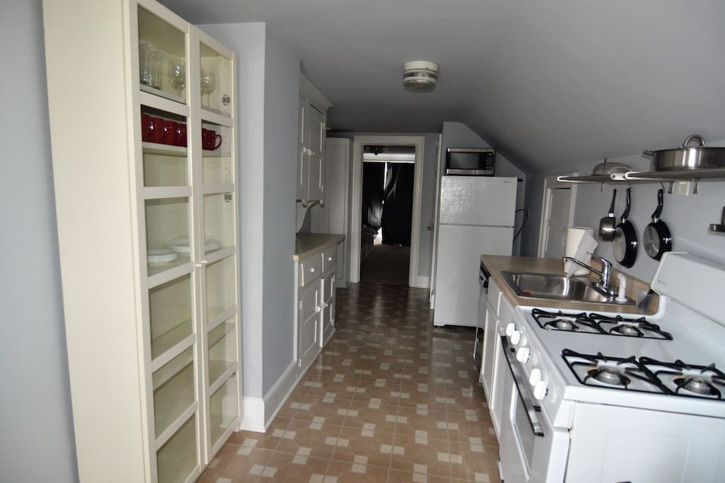 kitchen with dinning area. Fully equipped with appliances, plates, cooking pots, etc.