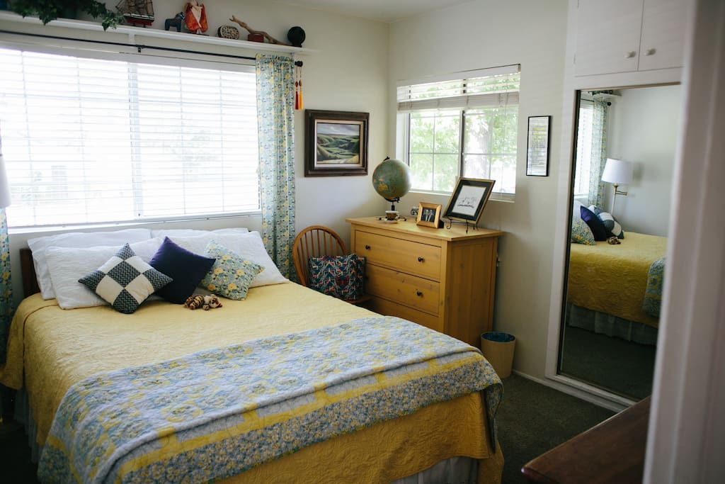 """ground floor """"tiger room"""" (see the tiger with the pillows?) with mirrored closet and dresser drawers."""
