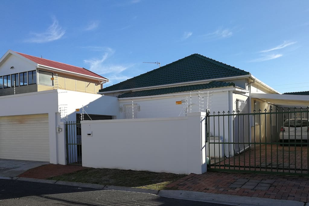 Front of the house with electric fencing, double garage and electronic sliding gate. Secure off street parking for 4 cars