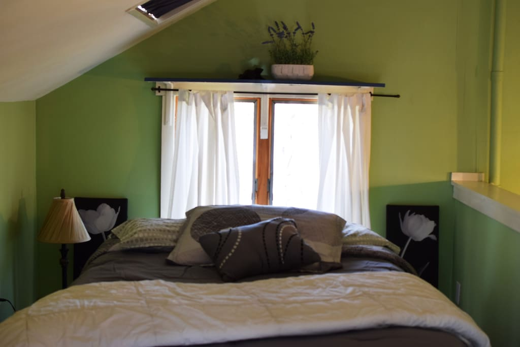 Lofted Bedroom | Features a full sized bed and dresser with four drawers for your belongings.