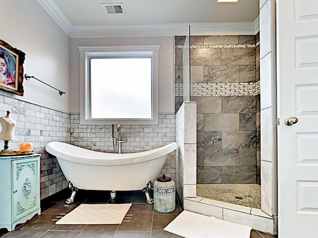 Gorgeous tile work, a walk-in shower, and a soaking tub round out the en-suite master bathroom.