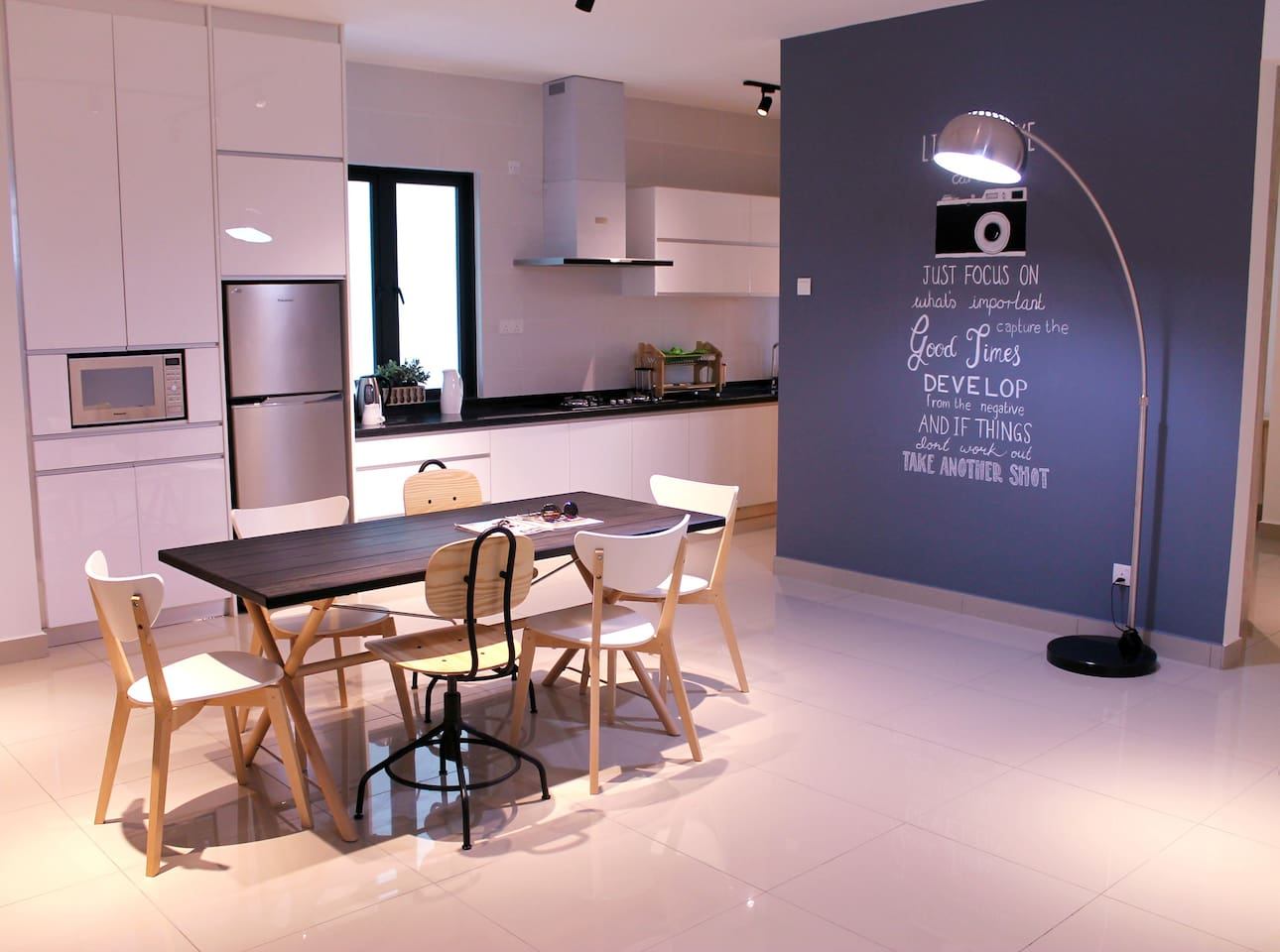 Spectacular view of the Dining table and kitchen with and amazing life quote