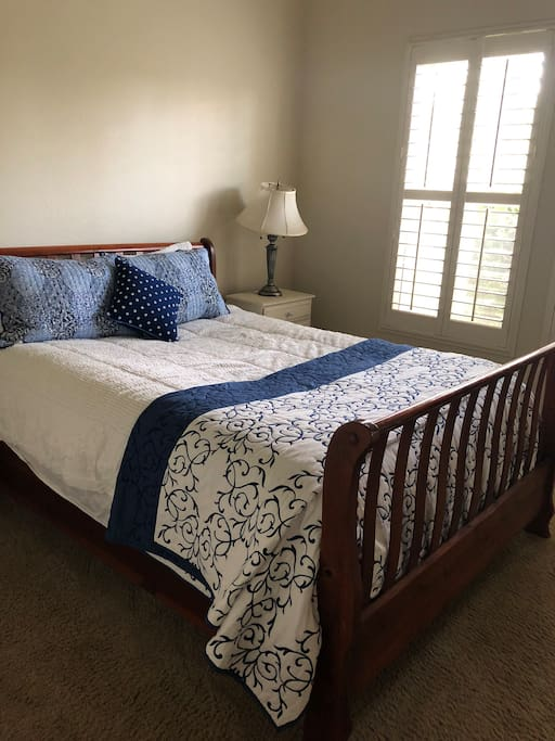 Comfortable queen bed with two large windows. Lots of closet space
