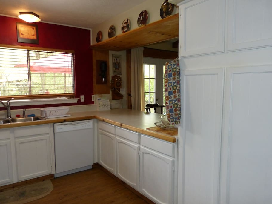 Kitchen looks out to private back yard